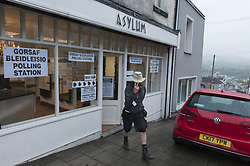 June 8, 2017 - Merthyr Tydfil, Glamorgan, Wales, UK - Merthyr Tydfil, Mid Glamorgan, Wales, UK. Early voters arrive to cast their vote at the hair salon Asylum. Damp and drizzly weather in the old mining town of Merthyr Tydfil as the polling tations open at 7.00am on the day of the general election in Wales, UK. (Credit Image: © Graham M. Lawrence/London News Pictures via ZUMA Wire)