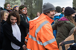 Dan Hooper, better known as roads protester Swampy in the 1990s, joins over one hundred people, including local residents, climate and land justice activists and pagans, at a Mass Trespass at Stonehenge on 5th December 2020 in Salisbury, United Kingdom. The trespass was organised in protest against the approval by Transport Secretary Grant Shapps of a £1.7bn project for a two-mile tunnel beneath the World Heritage Site and a further eight miles of dual carriageway for the A303, as well as the government's £27bn Road Investment Strategy 2 (RIS2).