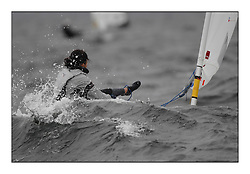 The penultimate days racing in the World Laser Radial Youth Championships, Largs, Scotland. ..Momoko Tada JPN 190954 gets into difficulties with a wave...317 Youth Sailors from 42 different nations compete in the World and European Laser Radial Youth Champiponship from the 17-25 July 2010...The Laser Radial World Championships take place every year. This is the first time they have been held in Scotland and are part of the initiaitve to bring key world class events to Britain in the lead up to the 2012 Olympic Games. ..The Laser is the world's most popular singlehanded sailing dinghy and is sailed and raced worldwide. ..Further media information from .laserworlds@gmail.com.event press officer mobile +44 7866 571932 and +44 1475 675129 .