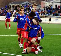 Fotball, Adecco-ligaen, 23.04.06, Tromsdalen - Moss<br /> Bjørn Strøm gratuleres av Leo Olsen og flere lagkamerater etter Tromsdalen-scoring.<br /> Foto: Tom Benjaminsen, Digitalsport