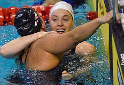 05-04-2015 NED: Swim Cup, Eindhoven<br /> Femke Heemskerk wint het koningsnummer de 100 meter en wordt gefeliciteerd door Ranomi Kromowidjojo