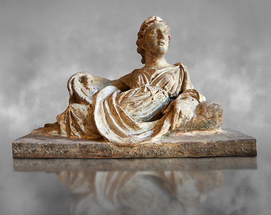 Etruscan Hellenistic style cinerary, funreary, urn  cover with a depiction of a women,  National Archaeological Museum Florence, Italy , grey art background .<br /> <br /> If you prefer to buy from our ALAMY PHOTO LIBRARY  Collection visit : https://www.alamy.com/portfolio/paul-williams-funkystock - Scroll down and type - Etruscan Florence - into LOWER search box. (TIP - Refine search by adding a background colour as well).<br /> <br /> Visit our ETRUSCAN PHOTO COLLECTIONS for more photos to download or buy as wall art prints https://funkystock.photoshelter.com/gallery-collection/Pictures-Images-of-Etruscan-Historic-Sites-Art-Artefacts-Antiquities/C0000GgxRXWVMLyc