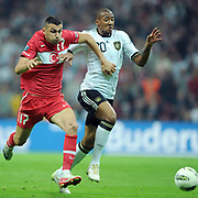 Turkey's Burak YILMAZ (L) and Germany's Jerome BOATENG (R) during their UEFA EURO 2012 Qualifying round Group A matchday 19 soccer match Turkey betwen Germany at TT Arena in Istanbul October 7, 2011. Photo by TURKPIX