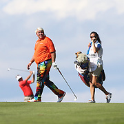 John Daly, USA, with his caddie, girlfriend Anna Cladakis,  during the first round of the Travelers Championship at the TPC River Highlands, Cromwell, Connecticut, USA. 19th June 2014. Photo Tim Clayton