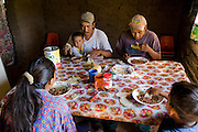 José Angel Galaviz Carrillo, a rancher of Pima heritage, having a meal with his wife and sons at their home in the Sierra Mountains, near Maycoba, in the Mexican state of Sonora.  (José Angel Galaviz Carrillo is featured in the book What I Eat: Around the World in 80 Diets.)