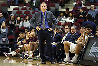 Texas A&M's head coach Billy Kennedy watches his team inbound a ball against Florida Gulf Coast University during a NCAA college basketball game in College Station, Texas, Wednesday, Dec. 2, 2015. Texas A&M's Anthony Collins (11) fouls   (AP Photo/Sam Craft)