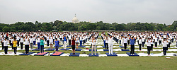 June 21, 2017 - Members of National Cadet Corps (NCC)  participated in a mega yoga event on the eve of International Day of Yoga on the Brigade Parade Ground in Kolkata , India on Wednesday , 21st June , 2017. The International Day of Yoga celebrated annually on June 21 was declares by United Nation. It was suggested by India Prime Minister Narendra Modi as it was the longest day of the year in the Northern Hemisphere and has special significance  in many parts of the world. (Credit Image: © Sonali Pal Chaudhury/NurPhoto via ZUMA Press)