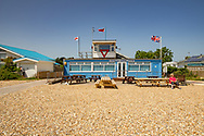 Club house for Pagham Yacht Club on the beach at Pagham on a summer day.