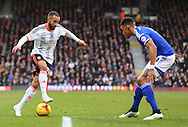 29. Ashley Richards dribbling and taking on 3. Tyrone Mings during the Sky Bet Championship match between Fulham and Ipswich Town at Craven Cottage, London, England on 14 February 2015. Photo by Matthew Redman.