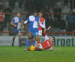 Bristol Rovers' Ellis Harrison is tackled - Photo mandatory by-line: Dougie Allward/JMP - Tel: Mobile: 07966 386802 14/12/2013 - SPORT - Football - Morecombe - Globe Arena - Morecombe v Bristol Rovers - Sky Bet League Two