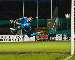 Ross County's keeper Antonio Reguero can''t stop Dundee's James McAlister goal. <br /> Dundee 1 v 1 Ross County, SPFL Premiership game player 4/1/2015 at Dundee's home ground Dens Park.