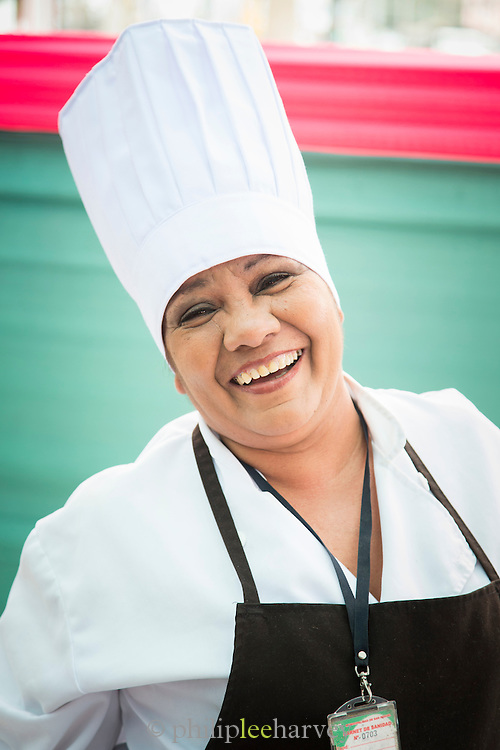Street food vendor preparing food for Judges of annual cooking competition, Lima, Peru, South America
