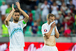 Bostjan Cesar of Slovenia and Ales Mertelj of Slovenia look dejected after the EURO 2016 Qualifier Group E match between Slovenia and England at SRC Stozice on June 14, 2015 in Ljubljana, Slovenia. Photo by Vid Ponikvar / Sportida