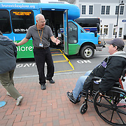 "11/17/11 -- BRUNSWICK, Maine. Driver Gregory Guckenburg, 62, shares a friendly laugh with Pam Boucher, 59, of Brunswick after helping her get off of the Brunswick Explorer.  ""If it wasn't for this bus we wouldn't get out to anywhere,"" said Boucher. Boucher and her friend, Becky Estabrook, left, who travels with her, were very positive about the bus, which seats as many as 15 people, including Boucher, who uses a wheelchair lock-in system. Photo by Roger S. Duncan."