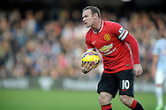 Wayne Rooney, the Manchester United captain holds the match ball. Barclays Premier league match, Queens Park Rangers v Manchester Utd at Loftus Road in London on Saturday 17th Jan 2015. pic by John Patrick Fletcher, Andrew Orchard sports photography.