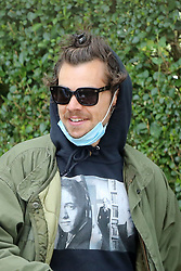 EXCLUSIVE: IN mask, hoodie and shades, this famous singer was only heading in One Direction to get his daily coffee fix. The former boyband member pulled his long hair into a man bun and clutched a coffee while out with friend and producer Ben Winston. In a bid to stop himself being recognised he was also wearing a hoodie and shades. Harry is back in the UK after being stuck in California at the beginning of the lockdown. 29 Jun 2020 Pictured: Harry Styles. Photo credit: MEGA TheMegaAgency.com +1 888 505 6342
