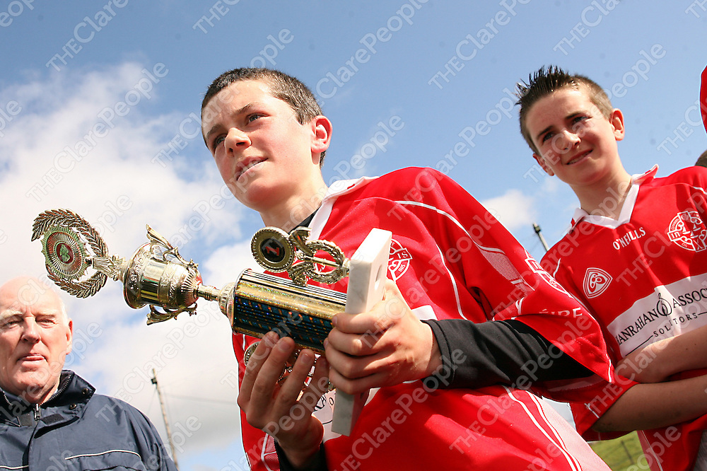 Eire Og captain Eanna Fennell lifts the trophy after his side beat Kilrush during their Feile Final clash in Coolmeen on Sunday afternoon.<br /> Photograph by Yvonne Vaughan