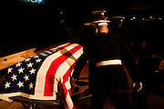 A member of the Marine Honor Guard straightens the flag on the casket carrying Lt. Madrazo...Service (Funeral) for Lt. Nicolas Madrazo of Bothell, Washington. Killed in Action September 9, 2008 in Afghanistan...Westminster Chapel, Bellevue, Washington.