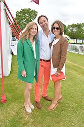 Left to right, ROSE FARQUHAR, JAMIE MURRAY-WELLS and LOTTIE FRY at the Cartier Queen's Cup Final polo held at Guards Polo Club, Smith's Lawn, Windsor Great Park, Egham, Surrey on 15th June 2014.