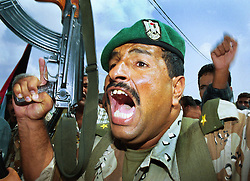 A Palestinian soldier expresses his anger at the funeral of Musbah Abdelgadr Abu Atig, 27, who was killed by Israeli soldiers a day earlier and  buried Tuesday, October 17, 2000 in Gaza.     (Photo by Ami Vitale)