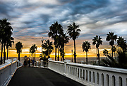 People Walking The Oceanside Pier During Sunset