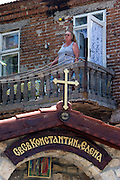 Sozopol, Bulgaria..A resident watches holidaymakers from her balcony overlooking one of many tiny private churches in the 6,000 year old town of Sozopol, which is visited by thousands of tourists every year