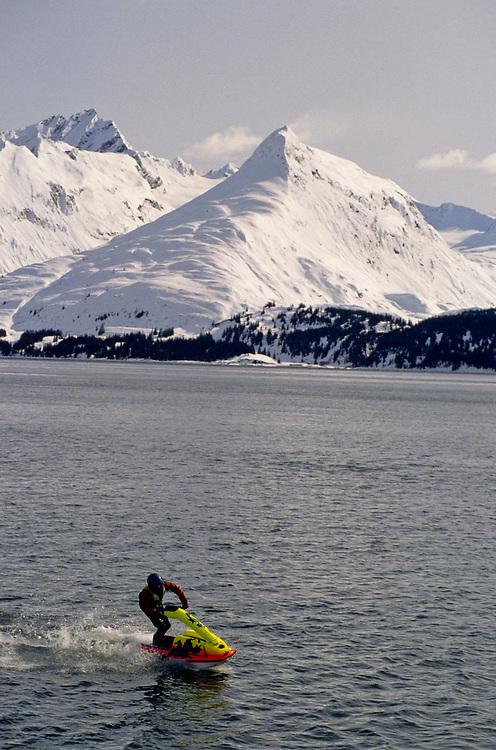 Alaska. Valdez. Prince William Sound. Chugach Mountains and jet - skier.