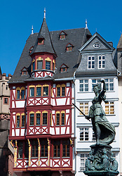 Romer Square with historic timbered houses  and Justitia statue at Frankfurt am Main in old town Germany