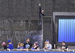May 12, 2017 - Kansas City, MO, USA - A fan raises the home run ball of Kansas City Royals designated hitter Brandon Moss after jumping in the fountain in the fifth inning of a game against the Baltimore Orioles on Friday, May 12, 2017 at Kauffman Stadium in Kansas City, Mo. (Credit Image: © John Sleezer/TNS via ZUMA Wire)