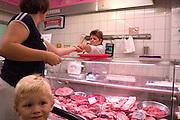 Upset boy in meat market on Lutomierska Street Balucki District Lodz Central Poland
