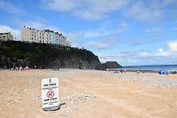 No dogs sign on South Beach, Tenby, Pembrokeshire South Wales July 2021