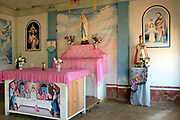 An altar in the Catholic church in Ka The Ko ethnic Kayan village on 17th January 2016, Kayah state, Myanmar. In the past most people residing in Kayah State were traditional spirit worshippers, but significant numbers have converted to Christianity, especially  Baptists or Catholics