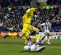 Photo: Mark Stephenson , Digitalsport<br /> West Bromwich Albion v Leeds United. The FA Cup. 06/01/2007.<br /> Leed's Tore Andre Flo  (L) is slide tackeled.