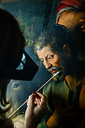 "Rome, the coservative studio Merlini Storti, Valeria Merlini during the cleaning phase of the painting ""Adoration of the Shepherds"" by Fabrizio Santafede, oil on panel, 16th century"
