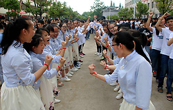 June 5, 2017 - Ji'An, Ji'an, China - Ji'an, CHINA-June 5 2017: (EDITORIAL USE ONLY. CHINA OUT) ..Senior high school students wear lucky bracelets at a high school in Ji'an, east China's Jiangxi Province, June 5th, 2017, hoping that they will have good luck during the upcoming National Higher Education Entrance Examination. (Credit Image: © SIPA Asia via ZUMA Wire)