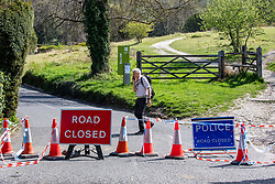 © Licensed to London News Pictures. 15/04/2020. London, UK. A man walks alone down Box Hill a beauty spot in the Surrey Hills which has been closed to traffic since lockdown due to the coronavirus pandemic as Ministers decide when and how the lockdown will finish as politicians are warned that the UK could face the worst recession in 300 years. Photo credit: Alex Lentati/LNP