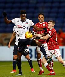 Bolton Wanderers' Sammy Ameobi battles for the ball with Bristol City's Ryan Kent.
