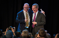 © Licensed to London News Pictures. 28/11/2016. London, UK. Nigel Farage (R) congratulates Paul Nuttall onstage as he is announced as the new leader of the UK Independence Party (UKIP), at the Emmanuel Centre in Westminster London. Photo credit: Peter Macdiarmid/LNP