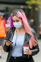 © Licensed to London News Pictures. 09/09/2020. London, UK. A woman wearing a face covering on Wood Green High Road, in the London Borough of Haringey as the number of COVID19 cases increases. As at Sunday, September 6, the government reported a three-month high in coronavirus cases in England, with 2,988 lab-confirmed cases reported on that day, the highest number of new cases since May. According to the figures published by the COVID-19 Symptom Study app, Newham, has most active cases among London boroughs, with 97 per 100,000 people.<br /> The London Borough of Haringey has 75.7 cases per 100,000 people. Britain could be facing a nationwide curfew as part of the efforts to avoid a second wave. Photo credit: Dinendra Haria/LNP