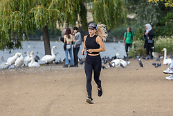 Licensed to London News Pictures. 03/09/202. London, UK. A runner in Hyde Park, London enjoys a bit of late summer sun with mild temperatures expected today with highs of 23c. Weather forecaster have predicted a mini heatwave from Sunday for England and the South East, with temperatures hitting over 28c on Monday. Photo credit: Alex Lentati/LNP
