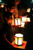 """August Obon celebrations culminate with Toro Nagashi """"the floating of lanterns"""" - paper lanterns are illuminated then floated down rivers or on the ocean signaling the ancestral spirits' return to the world of the dead."""