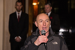 London, UK. 12th February, 2019. Chip Hamer, also known as Grim Chip, of Poetry on the Picket Line performs for members and supporters of grassroots trade union United Voices of the World protesting outside the Gadson Club in Pall Mall on the occasion of a reception with Justice Secretary David Gauke against his refusal to negotiate with the trade union over their demands for the London Living Wage, annual leave and sick pay for outsourced cleaners, security guards and receptionists working at the Ministry of Justice, all of whom have been on strike for varying periods recently. The Gadson Club is the official alumni club for the Oxford University Conservative Association.