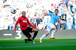 Manchester City's Aleksandar Kolarov crosses the ball into the box - Photo mandatory by-line: Dougie Allward/JMP - Tel: Mobile: 07966 386802 22/09/2013 - SPORT - FOOTBALL - City of Manchester Stadium - Manchester - Manchester City V Manchester United - Barclays Premier League