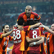 Galatasaray's Burak Yilmaz celebrate his goal with team mate during their Turkish Super League soccer match Galatasaray between Sivasspor at the TT Arena at Seyrantepe in Istanbul Turkey on Friday, 26 September 2014. Photo by Kurtulus YILMAZ/TURKPIX