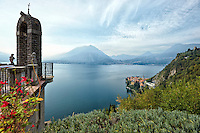 A view high above Lake Como, which includes an archway, and islands in the distance, Lombardy, Italy.