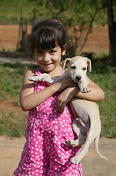 Young white girl with dog,