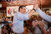 U.S. Senator and GOP presidential candidate Ted Cruz  high fives a supporter during a campaign stop at the Liberty Tap Room restaurant August 7, 2015 in Mt Pleasant, South Carolina. The event was the kick off for a seven-day bus tour called the Cruz Country Bus Tour of southern states.