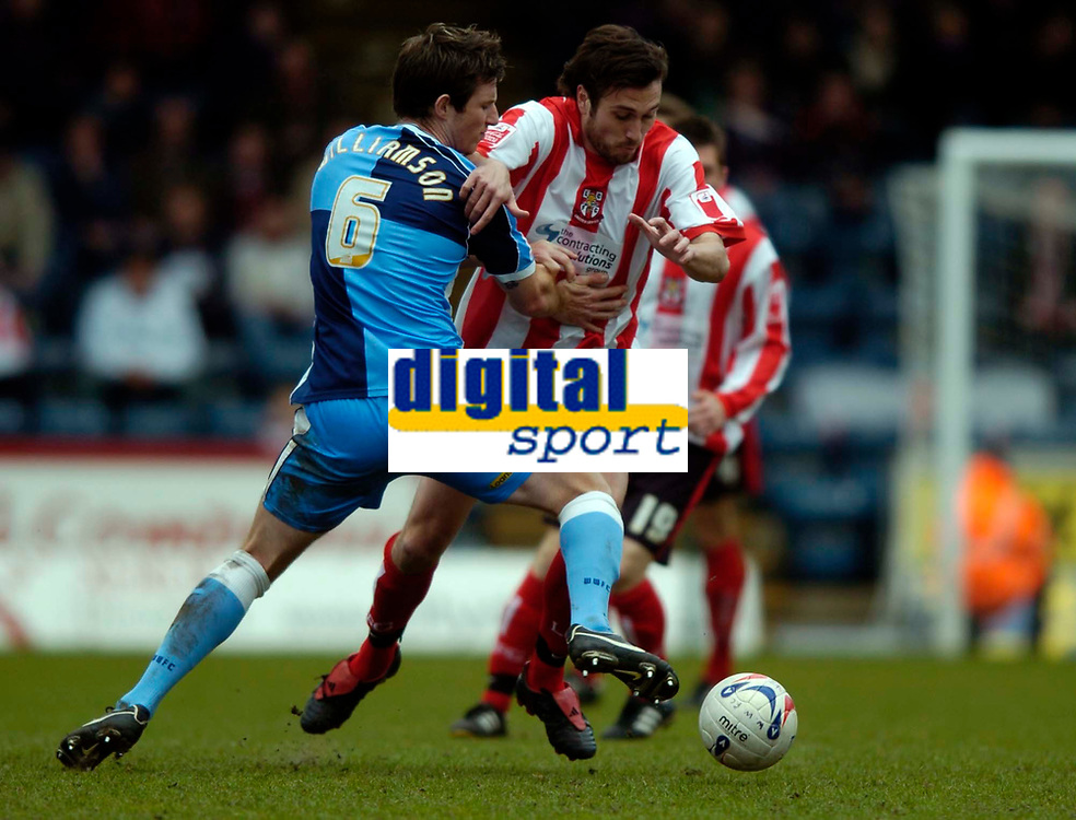 Photo: Richard Lane.<br />Wycombe Wanderers v Lincoln City. Coca Cola League 2. 17/04/2006. <br />Lincoln's Martin Gritton breaks past Wycombe's Mike Williamson.