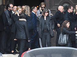 Milla Jovovich, Eva Herzigova leaving the funeral service for late photographer Peter Lindbergh held at Saint Sulpice church in Paris, France on September 24, 2019. Photo by ABACAPRESS.COM