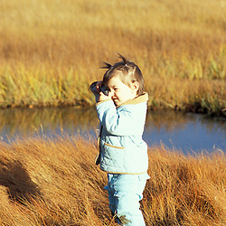 Biddeford, ME. A budding photographer takes pictures in a salt marsh near Biddeford Pool.  TPL project - Anuszewski property.